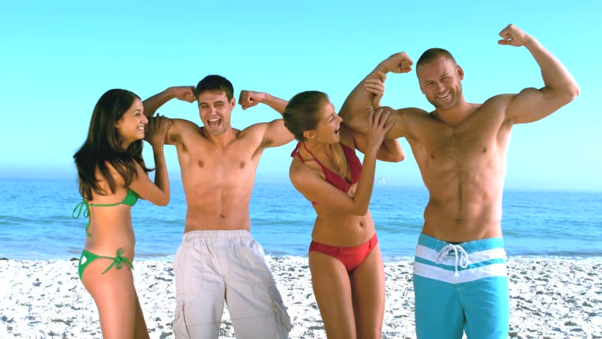 Women enjoying and adoring man with good biceps